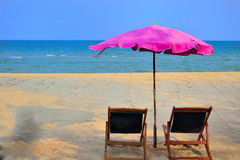 Relax on the beach. Pink beach umbrella in siam resort stock photography