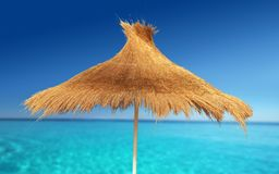 Relax Beach. Relaxing on Tropical Beach under umbrella on sunny day stock photo