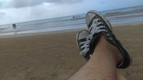 Relax at the beach with Conversesneakers Royalty Free Stock Photo