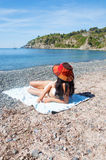 Relax at beach. Girl with red hat in relax on the beach Royalty Free Stock Photography
