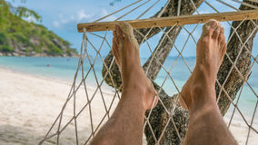 Relax on the Beach in Hammock, Haad Rin , Koh Pangang. Relax on the Beach in Hammock, Men Foots, Haad Rin Beach, Koh Pangang Royalty Free Stock Image