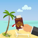 Relax on the beach, hand holding a passport against the sea and beach Stock Photography