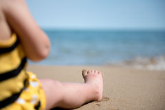 Relax on the beach. Portrait of small baby feet on a sand Royalty Free Stock Images
