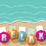 Relax beach umbrella ocean background Stock Photos