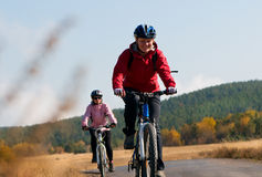 Relax biking. Two cyclists relax biking outdoors royalty free stock photo