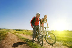 Relax biking. Two cyclists relax biking outdoors royalty free stock photography