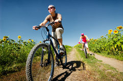 Relax biking. Women relax biking on summer road stock images