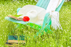 Relax with a book in the blooming spring garden Stock Photo