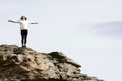 Relax and breathe. Yoga relax time on cliff in high mountains stock photo