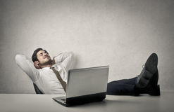 Relax. A businessman at work is taking a pause to relax royalty free stock image