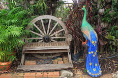 Relax chair with peacock sculpture Royalty Free Stock Photos