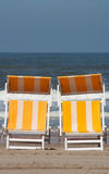 Relax chairs. Two beach chairs in the sand with the sea/ocean on the background, plenty of copyspace stock photography