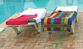 Relax chairs near the pool. With towels Stock Photo