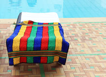 Relax chairs near the pool. With towels Stock Image