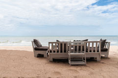 Relax chairs and tables along the beach Stock Images