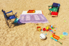 Relax with children on beach on golden yellow sand. Children toy. S are scattered in sand. Summer vacation on holidays Stock Photography
