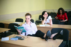 Relax in the classroom. But not all students Royalty Free Stock Photos