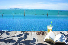 Relax cocktail book sun glass swimming pool island view Stock Image