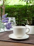Relax with Coffee in the garden. Coffee on wood table in the green garden Stock Photography