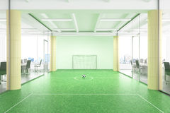 Relax concept Empty football field in modern office Stock Photo