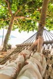 Relax on cradle. With beach background stock photo