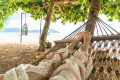 Relax on cradle. With beach background royalty free stock images