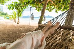 Relax on cradle. With beach background royalty free stock photo