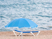 Relax on de beach. Blue umbrella an chair for relax in the beach Royalty Free Stock Images