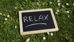 Relax escrita Imágenes de archivo libres de regalías