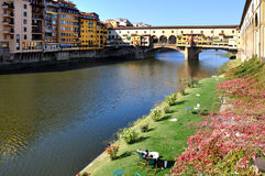 Relax in Florence in front of famous bridge Stock Photo