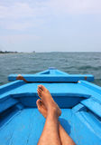 Relax Foot on Blue Boat Royalty Free Stock Photography