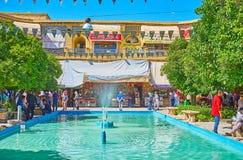 Relax at the fountain, Saraye Moshir Bazaar, Shiraz, Iran. SHIRAZ, IRAN - OCTOBER 14, 2017: Numerous visitors in Saraye Moshir Bazaar - the scenic open air royalty free stock photos