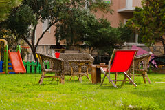 Relax furniture group in the green grassed garden Stock Photography