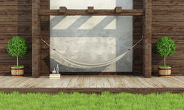 Relax in a garden with hammock. Garden in rustic style with wooden wall and hammock- 3d rendering Royalty Free Stock Images