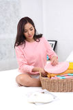 Relax girl sitting on bed. Stock Photo