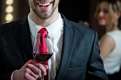 Relax with glass of wine in hand of smiling man royalty free stock photos