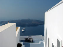 Relax at the greek islands. Incredible island patio with view to ship cruising at Greek Island stock photos