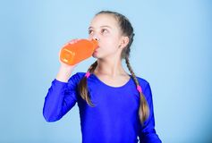 Relax after gym workout of teen girl. Resting time. Childhood activity. Sport and health. Little girl drink water from. Bottle. Happy child sportsman. Fitness stock photography