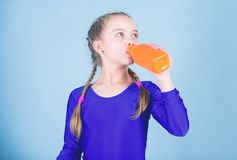 Relax after gym workout of teen girl. Resting time. Childhood activity. Sport and health. Little girl drink water from. Bottle. Happy child sportsman. Fitness royalty free stock images