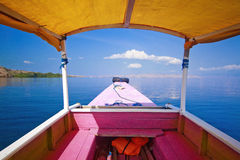 Relax. Hiding in the shadow,from the heat, my boat is on it's way from Lombok to the national reserve of Comodo,Indonesia. The silence and calmness of the scene Stock Photos