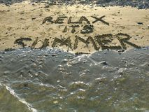 Relax its Summer. Text written on the sand of ladys mile beach at Limassol stock images