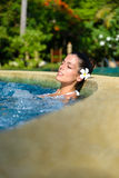 Relax in jacuzzi spa. Beautiful woman enjoying relax in spa pool at resort. Beauty and body care concept royalty free stock photos