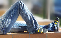 Relax on Jeans. A boy is sleeping and his legs is waiting to jump again Royalty Free Stock Photo