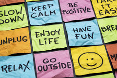 Relax, keep calm, enjoy life. And other motivational lifestyle reminders on colorful sticky notes Royalty Free Stock Image