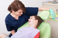 Relax kid laughing in dentist chair Royalty Free Stock Images