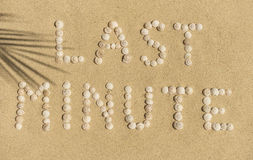 Relax - LAST MINUTE. LAST MINUTE written with snail shells Stock Image