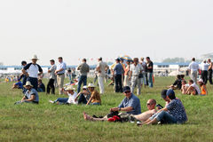 Relax on the lawn. Group of people vacationing on a Sunny day on the lawn Stock Image