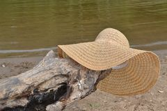 Relax leisure travel hat river beauty nature tranquility harmony. Hat, , straw, fashion, white, clothing, summer, sun, brown, object, cowboy, accessory, cap Stock Images