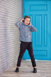 Relax and listening music concept. European boy fill the bit. Boy in casual wear. Royalty Free Stock Image