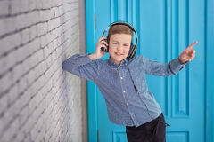 Relax and listening music concept. European boy fill the bit. Boy in casual wear. Royalty Free Stock Images